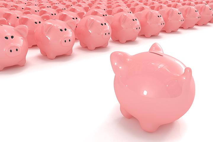 Piggy bank facing hundreds of other piggy banks